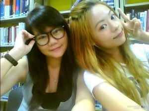 Nong Noey (right side) and her friend at Library, TMC Singapore