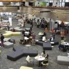 students_at_desks_couches_level_two_puaka_library_INT_feature